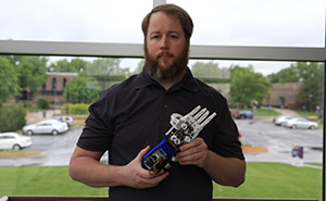 Brad Newby with his Robotic Prosthetic Hand