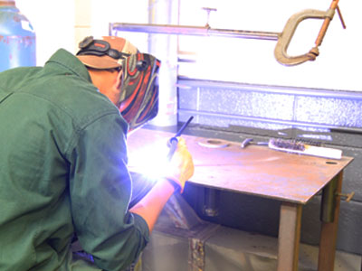 Welding student practicing new skills