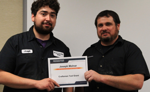 Joseph Molnar with Instructor Donnie Smith holding his scholarship certificate