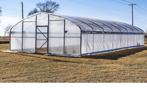 A high tunnel greenhouse sits on the Butler agriculture department lawn.