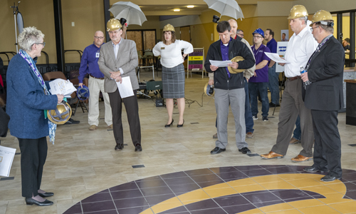 Butler administration stand in the Student Union main lobby of the Andover 5000 Building.
