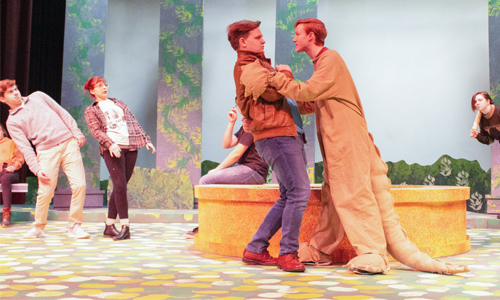 College theatre students rehearse on stage.