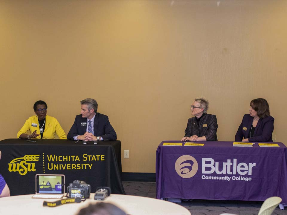 Administration from WSU and Butler Community College sign articulations.