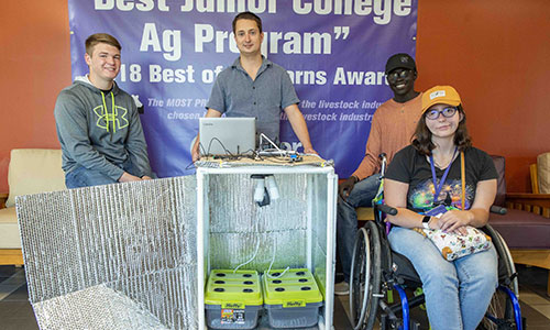 "Butler Agriculture Professor Builds ""Food Computer"" for Student Learning - Professor Foust and three students pose by the ag computer."