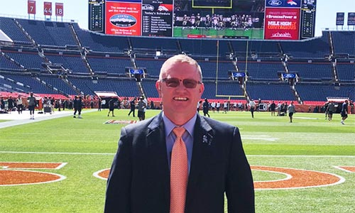 Butler alumni Patrick Tetrick stands before the Bronco's Stadium