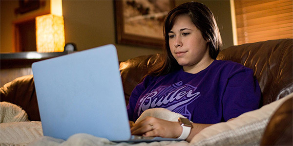 Butler online student checking out degrees
