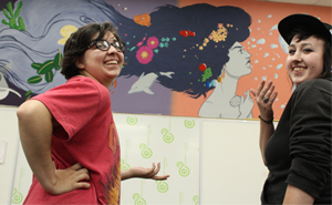 Butler students paint a mural in refurbished classroom.