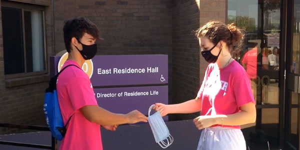 College health and counseling student volunteers handing out face masks during fall semester during covid 19 pandemic
