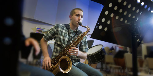 Instrumental music student plays saxophone near Wichita at Butler Community College