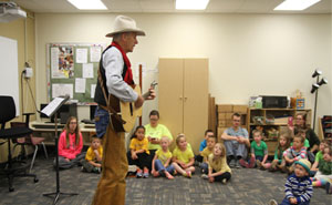 Orin Friesen the singing cowboy sings to Butler EduCare students.