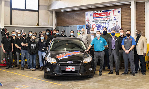 Butler Auto Tech students and faculty pose with representatives from Ford Motor Company and Rusty Eck Ford during Car Donation on October 8