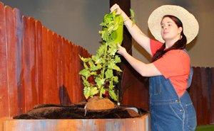 Miranda Kimble plays the Tomato Plant Girl