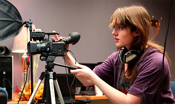 Digital media specialist student sets up a camera during class at Butler near Wichita, Kansas